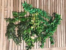 A large selection of artificial plants for reptile terrariums/vivariums