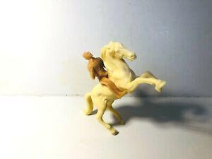 Vintage Stuart tan rider on rearing tan horse