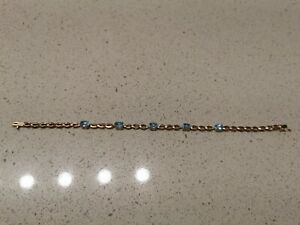 "14k Yellow Gold Genuine Blue Topaz Bracelet 7.25"""