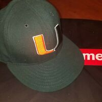 New Era Miami Hurricanes Green 59FIFTY Fitted 6 7/8 Kids Hat.