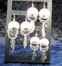 Three Peruvian stainless steel earrings , it's coins stands out with brightness.