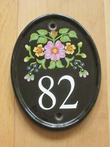 Oval Black Floral / Flower Pattern Ceramic House Number 82 Plaque Sign.