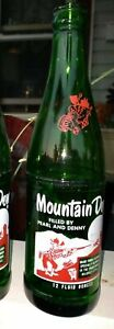 Mt. Dew, 12oz acl soda bottle. Filled by Pearl and Denny. 1965
