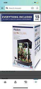 15 gallon aqueon fish tank starter kit including rocks, light, heater, and net.