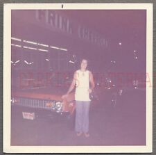 Vintage Car Photo Girl & New 1973 Chevrolet Nova Automobile at Dealership 688194