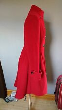Beautiful hand made and designed warm red wool coat. Fit 12-14. tall?