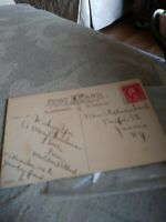 Washington. Red 2 cent stamp on Christmas postcard / unused stamp with tear.