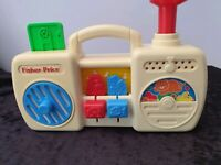 VINTAGE FISHER PRICE MUSICAL BOOM BOX push red handle up/down to activate music.