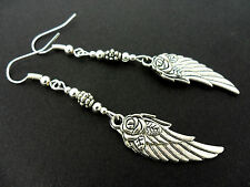 A PAIR OF  TIBETAN SILVER WING FEATHER FLOWER  EARRINGS. NEW.