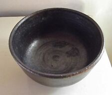"ONE Toshiko Takaezu bowl, dark brown glaze. 5"" d. 2 3/4"" h. Signed."
