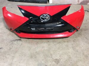 TOYOTA AYGO  1.0 PETROL FRONT BUMPER IN RED COMPLETE 52112-0H020 2015