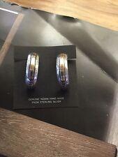 Sterling Silver and 14 K Gold, hand crafted Navajo half hoop earrings..