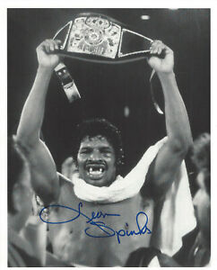 Leon Spinks autographed 8x10 b/w photo Holding Championship Belt