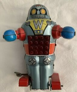 Noguchi Tin Litho wind up foot paddle Robot made in Japan 1960's.