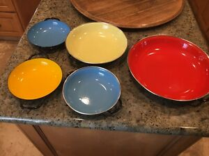 VINTAGE ENAMELWARE PANS. STACKING AND COLORFUL. POLAND AND YUGOSLAVIA MADE