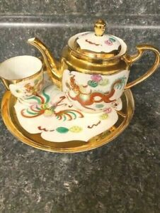 Beautiful vintage Gold, Red, and White Dragon Tea Set with Serving Tray