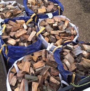 2 X bulk/ton/builders bags seasoned hardwood logs dry stored in a vented barn