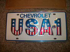 NOS Small hole USA-1 U.S.A.-1 Chevrolet GM Dealer Dealership License Plate Nice!