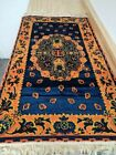 Small Oriental styled floor rug with fringe trim
