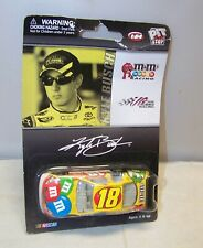 1:64 2009 ACTION #18 M&M's TOYOTA CAMRY KYLE BUSCH CARDED NIP CARD CREASED READ
