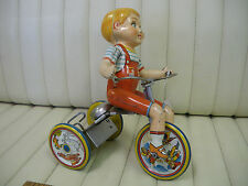 1930s Unique Art Kiddy Cyclist Wind Up Lithographed Tin Toy