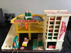 VINTAGE FISHER PRICE GARAGE WITH CARS AND FIGURES
