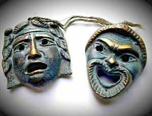 Ancient Masks of Greek Tragedy: Thalia and Melpómenes. Antique solid bronze.