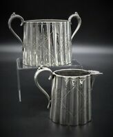MATCHING EDWARDIAN STYLE VINTAGE CHASED SUGAR BOWL AND CREAM JUG SILVER PLATED