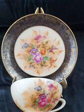 *C) Porcelana Tsuji Arjentin vintage tea cup & saucer black & gold w/ flowers