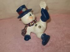 Ceramic Tumbling Snowman with Star Figurine
