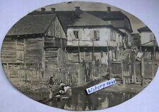 Foto : KOWEL - RUSSLAND mit Ortskern und Volkstypen am Fluss. (V)