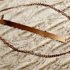 rose gold accent belt with panel and chain detail super long