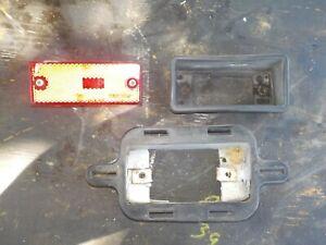 86-90 Nissan Sentra Rear Bumper: Passenger Right Side Red Marker Light Signal