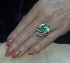 Vintage 7.85 Ct Round Emerald and Baguette, Marquise Cut Diamonds Cluster Ring