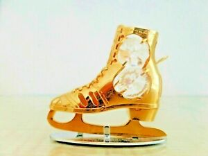 Two Crystal Temptations Gold Ice Skating Boots on Stand with Swarovski Elements.