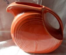 VINTAGE Fiesta Fiestaware Large Orange Pitcher with handle and pour spout.