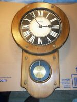 Vintage clock grandfather style wall clock.