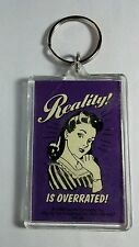 AS-IS REALITY IS OVERRATED FUNNY FUN PURPLE HUMOR RETRO KEYCHAIN KEY CHAIN AS-IS