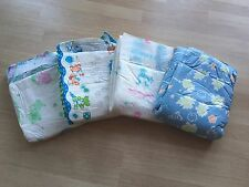 4 mixed medium adult nappies. ABDL. Snuggies, ABU space, Little Pawz, Cuddlz