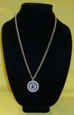 Oloha Hawaii & an Islander Dancing Necklace with a Spinning Silver Tone Pendant,