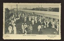 Railway Station busy scene locals and colonials RP PPC