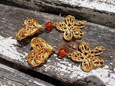 Paire de boucles d'oreilles vintage Yves Saint Laurent Rochas dorées