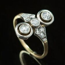 ANTIQUE ART DECO DIAMOND THREE STONE HALO TARGET RING