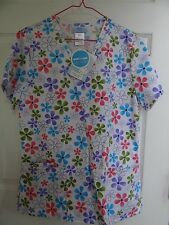 SCRUBS TOP BRAND NEW  SMALL SIZE,, FLORAL WHITE BACKGROUND, VERY COLORFUL!!!