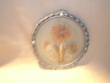 Pressed real flowers suncatcher with metal sealed edge. Beveled edge metal.