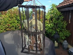 Halloween Shaking Animated Skeleton in a Cage with Chains Flashing Eyes Sound