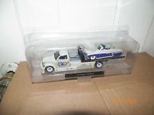 1 Maisto Elite Transports Police Flatbed & 1950 Mercury (BAD PACKAGE)