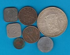 SEVEN COINS FROM THE NETHERLANDS 1827 TO 1942 IN FINE OR BETTER CONDITION