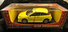 Motorworks Ford Focus ZX3 Yellow hatchback in 1/18