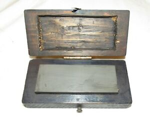 old sharpening stone in wooden box / case old tool woodworking tool